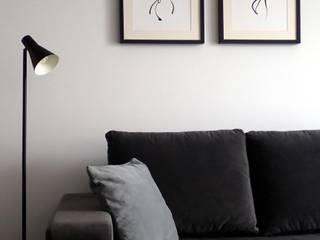 Męski minimalizm Minimalistyczny salon od Aleksandra Jaros Pracownia Architektury i Wnętrz Minimalistyczny