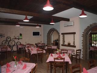 LA LOCANDA DEL GIGANTE Gastronomia in stile rustico di Luigi Nevola Architetto Rustico