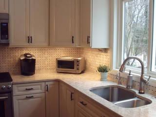 Light, Bright, White Kitchen:  Kitchen by Kitchen Krafter Design/Remodel Showroom