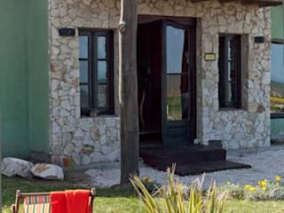 Houses by Susana Bellotti Arquitectos, Rustic