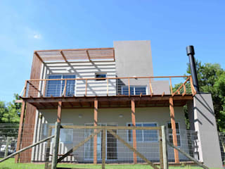 Residencia Ibiraquera I: Casas  por CASA arquitetura