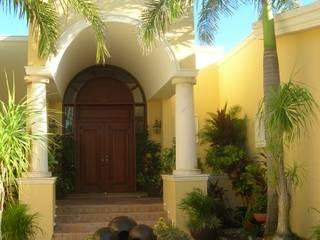 SG Huerta Arquitecto Cancun Casa unifamiliare Laterizio Giallo