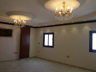 Living room by Etihad Constructio & Decor