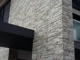 Revestimento fachada exterior: Casas modernas por Fábrica de Pavimentos Aptus, S.A.