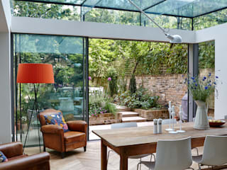 Single Storey Rear structurally glazed Extension with minimal frame triple track sliding doors Trombe Ltd Comedores modernos