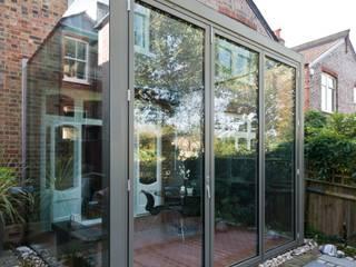 Frameless Glass Box Extension Trombe Ltd Comedores modernos