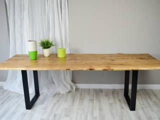 Live edge Oak slab dining table on steel legs:   by Frances Bradley