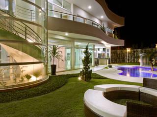 Casa Malibu: Casas  por Arquiteto Aquiles Nícolas Kílaris