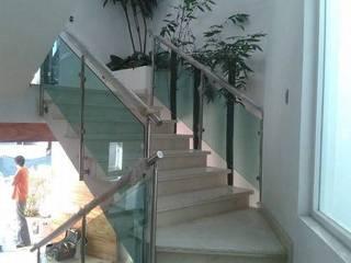 Pasillos, vestíbulos y escaleras modernos de ORO ARQUITECTURA Moderno