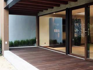 Casas estilo moderno: ideas, arquitectura e imágenes de Taller Plan A Moderno