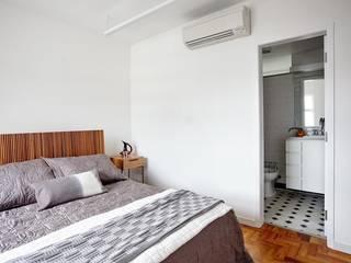 Projekty,  Sypialnia zaprojektowane przez INÁ Arquitetura