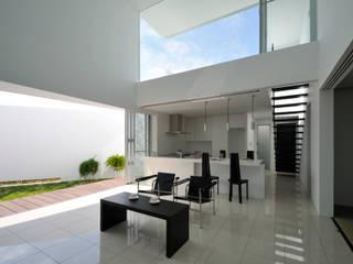 Modern living room by 門一級建築士事務所 Modern