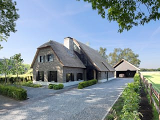 Country style house by Vermeer Architecten b.v. Country