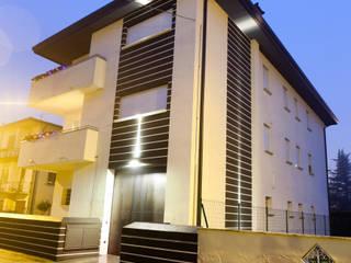 Casas estilo moderno: ideas, arquitectura e imágenes de SANSON ARCHITETTI Moderno