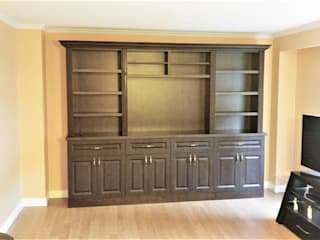Living room by Space Age Custom Closets & Cabinetry,