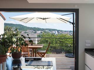 Extension d'une maison individuelle à Maxéville: Cuisine de style de style Moderne par nine architectes