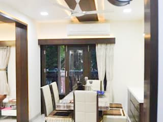 Residence of Mr Mukesh Shah:  Dining room by Sanchi Shah