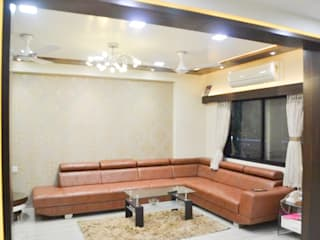 Residence of Mr Mukesh Shah:  Living room by Sanchi Shah