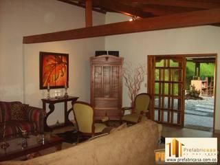 Rustic style living room by PREFABRICASA Rustic