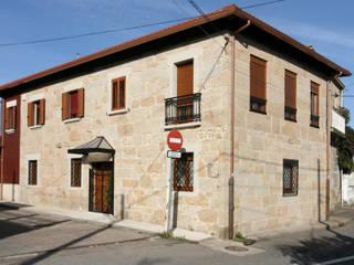 Estado reformado de la fachada: Casas de estilo  de NAM ARQUITECTOS SLP