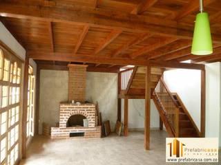 Casa pre fabricada en bogotá 2 Salas modernas de PREFABRICASA Moderno