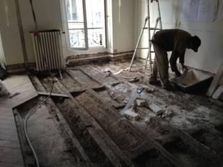 RESTRUCTURATION D'UN APPARTEMENT PARISIEN: Salle à manger de style  par Eric Rechsteiner