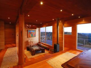 Casa Muelle Livings de estilo de Jonás Retamal Arquitectos Rural