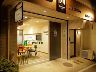 株式会社Juju INTERIOR DESIGNS Offices & stores Wood Orange