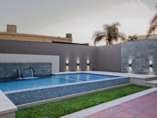 REFORMA: Piletas de estilo moderno por D'ODORICO OFICINA DE ARQUITECTURA