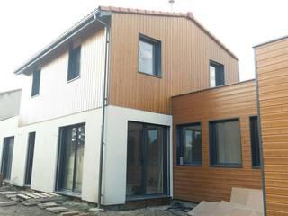 Maison ossature bois Pyrénées- LE VERNET: Maisons de style de style Moderne par Falco Construction Bois