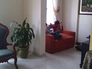 Salas de estar campestres por ECODISEÑO MUÑOZ S.A.S. Campestre