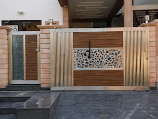 Main Gate Design:  Houses by RAVI - NUPUR ARCHITECTS