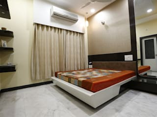 Guest Room:  Bedroom by RAVI - NUPUR ARCHITECTS