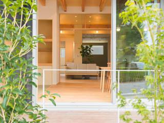 公園前の2世帯の住まい: m+h建築設計スタジオが手掛けた庭です。