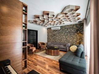 Colina 2122: Salas de estilo  por ESTUDIO TANGUMA