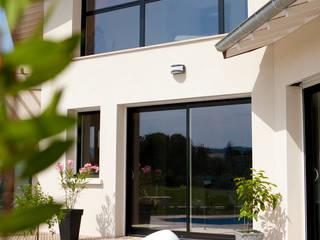 Maison Basse Consommation: Maisons de style  par Val de Saône Bâtiment