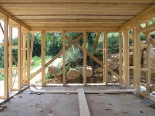 casa in balle di paglia: Case in stile In stile Country di architetture e restauri biocompatibili