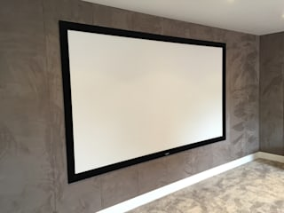 Cinema Room with bespoke suede fabric walls:  Media room by Designer Vision and Sound