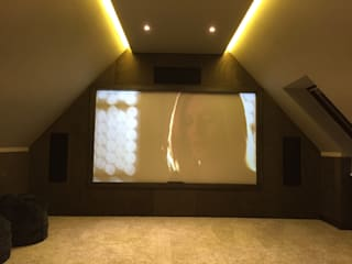 Loft Cinema Room with fabric walls and LED lowered ceiling:  Media room by Designer Vision and Sound
