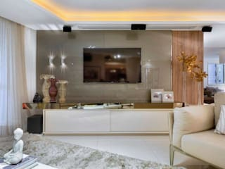 Apartamento unifailiar : Salas de estar  por Lícia Cardoso e Rafaella Resende
