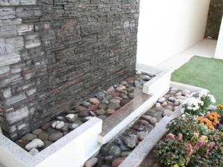 Fuente Jardines de estilo moderno de Daniel Teyechea, Arquitectura & Construccion Moderno