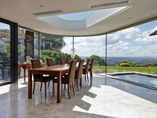 Curved Glass Extension Modern dining room by Trombe Ltd Modern