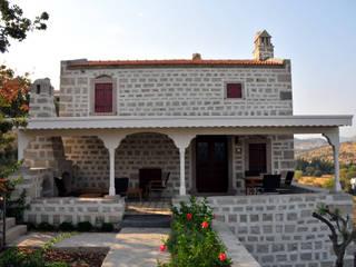 Ebru Erol Mimarlık Atölyesi – YARBASAN TAŞ EVLERİ:  tarz Evler