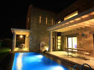 Hoteles de estilo  de Ebru Erol Mimarlık Atölyesi