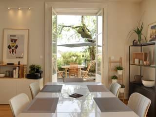 Séjour pièce à vivre: Salle à manger de style  par SLAI