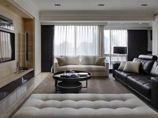 時尚精品宅:  客廳 by 大荷室內裝修設計工程有限公司