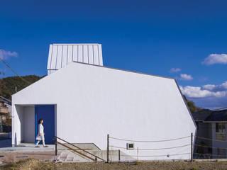 白い林檎: 奥和田健建築設計事務所 okuwada architects officeが手掛けた家です。
