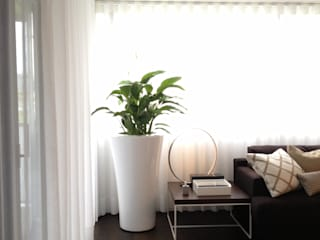APARTAMENTO ZURIQUE: Salas de estar minimalistas por AROSO MACHADO