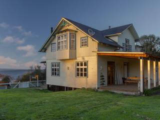 Case in stile scandinavo di Moraga Höpfner Arquitectos Scandinavo