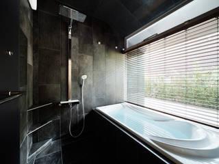 松島潤平建築設計事務所 / JP architects Eclectic style bathroom Stone